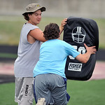 Big Horn's Jeremy Wolfe, left, holds a pad as teammate Andrew Ratty demonstrates a tackling drill during the Justin O'Dell Memorial football camp on Thursday, June 9 at Big Horn High Sch ...