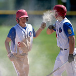 Sheridan's Nolan McCafferty, right, bumps knuckles with Kade Eisele after Eisele dove safely into home during the Troopers 9-6 win over the Billings Halos on Monday, June 6 at Thorne-Rider ...