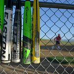 Justin Sheely | The Sheridan Press Bats hang in a dugout during the Sheridan Recreation District's Adult League Softball Wednesday night at the Sheridan College Campus.