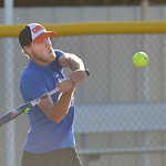 Justin Sheely | The Sheridan Press Cas Brewer swings at the ball during the Sheridan Recreation District's Adult League Softball Wednesday night at the Sheridan College Campus.
