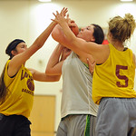 Tongue River's Kylee Knobloch, center, makes a post move between two Big Horn defenders on Tuesday, May 31 at Big Horn High School. The two teams scrimmaged as part of an ongoing summer se ...