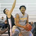 Darius Jackson, right, goes under the basket for a reverse layup on Friday, Dec. 2 at the Bruce Hoffman Golden Dome. Jackson led all scorers with 20 points in Sheridan College's win over D ...