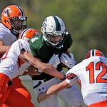 Tongue River quarterback Brennan Kutterer, center, tries to break through a group of Cokeville tacklers on Saturday, Sept. 17 at Tongue River High School. The Eagles lost 12-7. Mike Pruden | ...