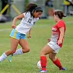 Sheridan College's Jasmin Vega, left, changes direction in front of a Northwest defender on Wednesday, Sept. 21 at Maier Field. Mike Pruden | The Sheridan Press