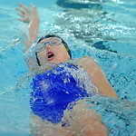 Piper Carroll competes in the 100-meter backstroke at the Sheridan Invite on Saturday, Sept. 24 at Sheridan Junior High School. Mike Pruden | The Sheridan Press