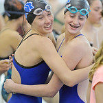 Piper Carroll, left, hugs teammate Zoe Robison after the two helped break the school record in the 200-meter freestyle relay on Saturday, Sept. 24 at Sheridan Junior High School. The pair, a ...