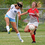 Sheridan College's Sidney Burrell, left, sends a cross past Northwest College's Holly Burley on Wednesday, Sept. 21 at Maier Field. Mike Pruden | The Sheridan Press
