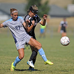 Otero's Cassandra Moosburger, left, tries to step over Sheridan College's Sidney Burrell during a match on Saturday, Sept. 10 at Maier Field. Mike Pruden | The Sheridan Press