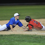 Nolan McCafferty, left, makes a diving tag at third base Sunday evening at Thorne-Rider Stadium. Mike Dunn | The Sheridan Press.